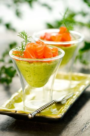 avocado cream and salmon in glasses photo