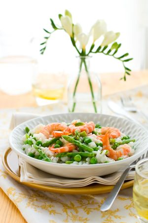 italian risotto with asparagus, shrimp and green pea photo