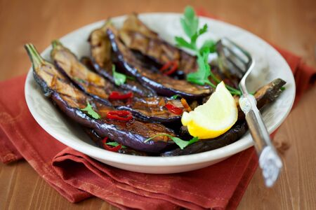 Grilled aubergines with garlic,chilli  and ginger sauce-marinade Stock Photo - 7008521