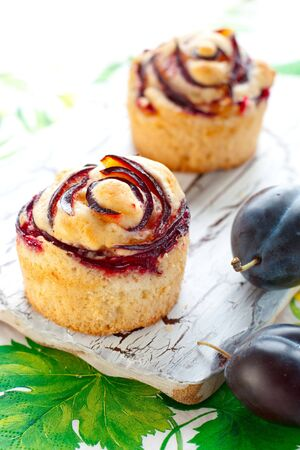 delicious muffins with plums Stock Photo