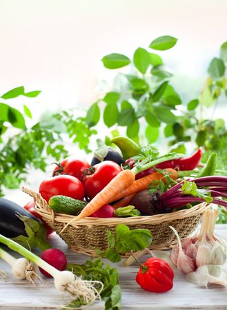 Different fresh vegetables on the table photo