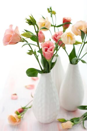 Bouquet of pink lisianthus in vase photo