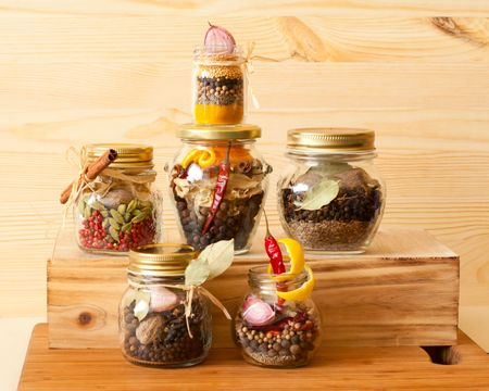Various sets of spices  in glass jars for marinades and dressings photo