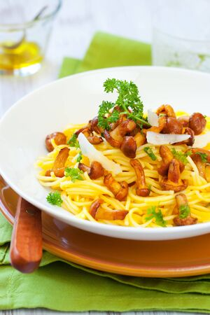 spaghetti  with chanterelles,parsley and grated parmesan Stock Photo