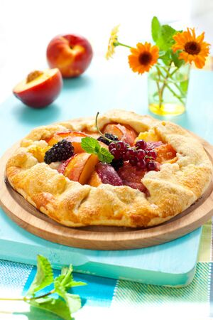 peach galette with blackberry and red currant photo