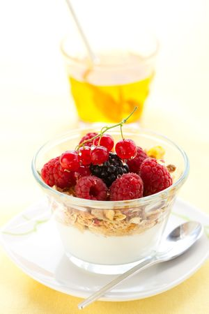 yogurt with muesli ,berries and honey photo