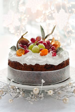sugared: Traditional Christmas fruit cake with white frosting and sugared fruits Stock Photo