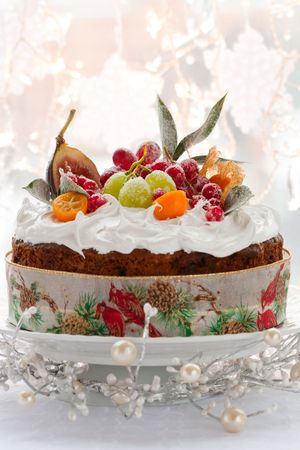 Traditional Christmas fruit cake with white frosting and sugared fruits photo