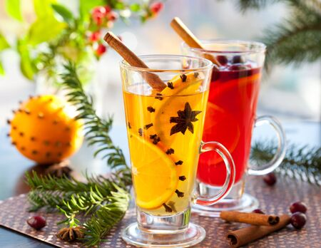 grog: Orange and cranberry  punch with orange slices and spices.Hot drinks for winter and Christmas