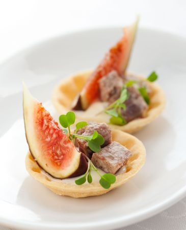 canape: Fig and pate tartlets for Christmas dinner Stock Photo