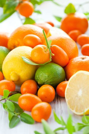 Citrus fresh fruit on the white wooden table Stock Photo - 8200928