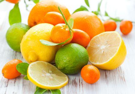 Citrus fresh fruit on the white wooden table Stock Photo - 8200931