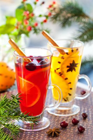 Orange and cranberry  punch with orange slices and spices.Hot drinks for winter and Christmas photo