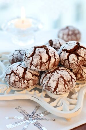 Chocolate biscuits with icing sugar photo