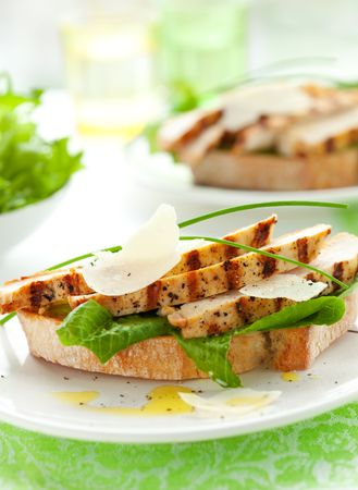 chicken caesar salad: Open chicken Caesar sandwich on the white plate Stock Photo