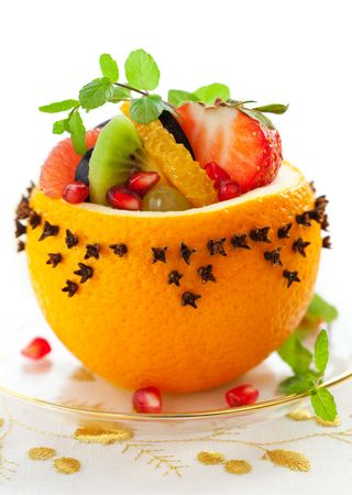 fruit salads: Fruit salad in  hollowed-out oranges studded with cloves   for Christmas