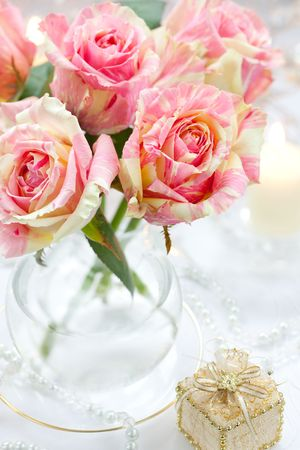 Bouguet of pink roses in vase,candle and little gift box Stock Photo - 8219456