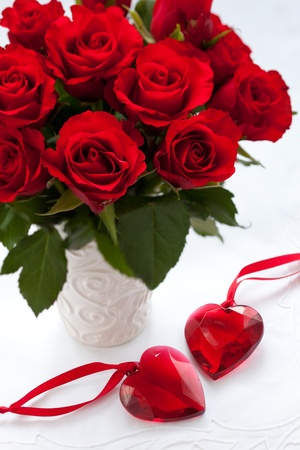 flower vase: red roses in vase and hearts for Valentines Day Stock Photo