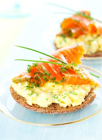 Scrambled egg and smoked salmon on toast photo