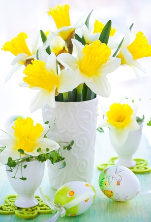 Easter decoration: narcissi in vase and eggcups photo
