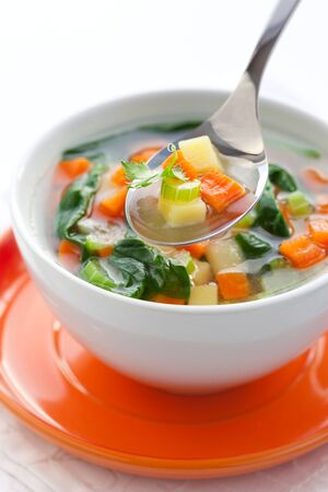 broth: vegetable soup with potato,carrot,celery and spinach Stock Photo
