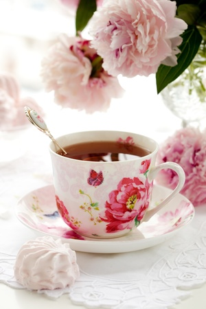 tea light: A cup of black tea,sweets and peonies