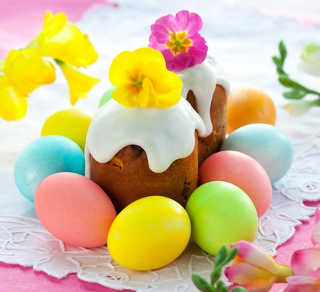 Easter cake with glace icing and coloured easter eggs photo
