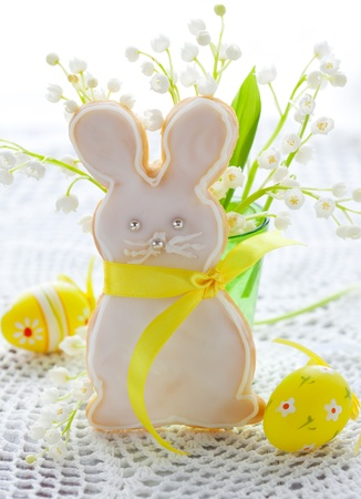 Homemade Easter bunny cookie and lily-of-the-valley photo