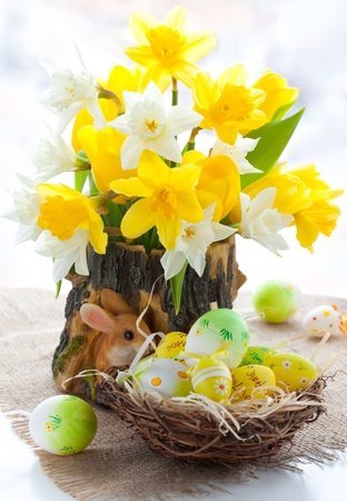 bouquet of the fresh tulips , narcissus and easter eggs  for Easter photo