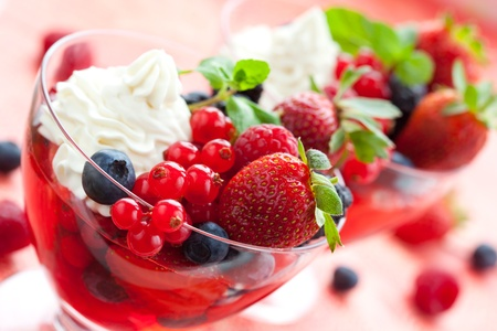 Berries in jelly  with cream and fresh fruits in glasses Stock Photo - 9506779
