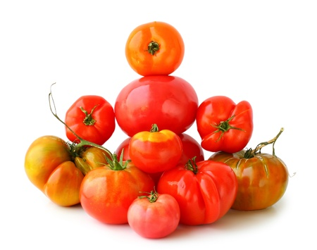 Different fresh tomatoes on the white background photo