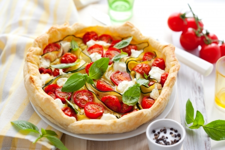 egg tart: Quiche with tomato,zucchini and cheese with basil Stock Photo