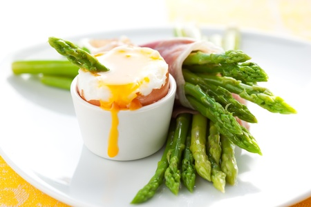 green asparagus with soft-boiled egg and  ham photo