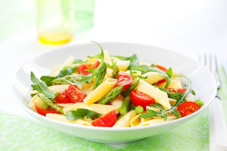 penne pasta: Pasta penne with asparagus,tomato and rucola in bowl Stock Photo