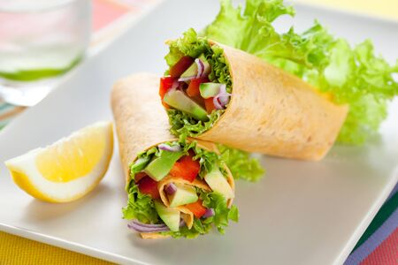 fresh  tortilla wraps with vegetables on the plate photo