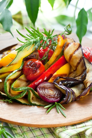 Grilled vegetables with rosemary and thyme on the wooden plate Stock Photo