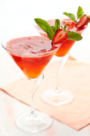 Cold strawberry drink with mint photo