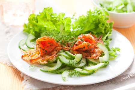 Potato rosti with smoked salmon and cucumber salad photo