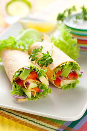 taco tortilla: fresh  tortilla wraps with vegetables on the plate