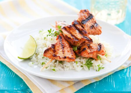 Delicious chicken masala skewers with rice Stock Photo
