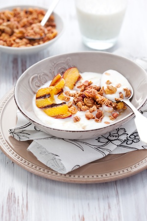 Breakfast with muesli,yogurt and grilled peaches Stock Photo - 9844472