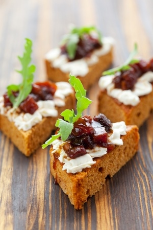 canape: Pumpkin and tomato chutney on pumpkin bread with soft cheese Stock Photo