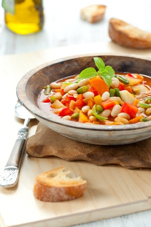 Bowl of minestrone soup with bread Stock Photo - 10066000