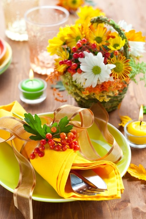 autumnal place setting with backet of autumn flowers Stock Photo - 10066013