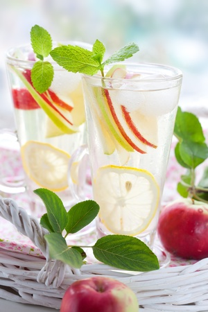 liquid summer: Drink with lemon,mint and ice cubes