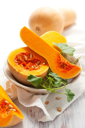 Butternut squash, whole and halved photo