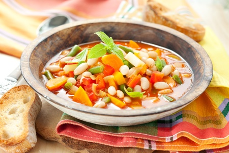 stew: Bowl of minestrone soup with bread