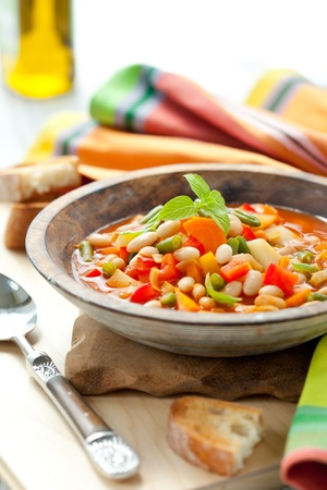 minestrone: Bowl of minestrone soup with bread