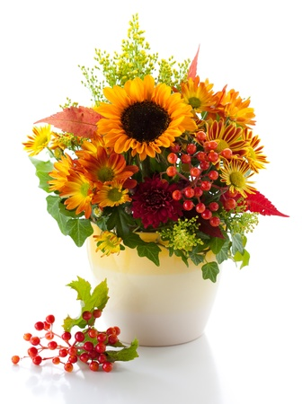 still life with autumnal flowers and berries photo