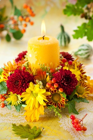 beautiful thanksgiving: autumn wreath with yellow candle and flowers